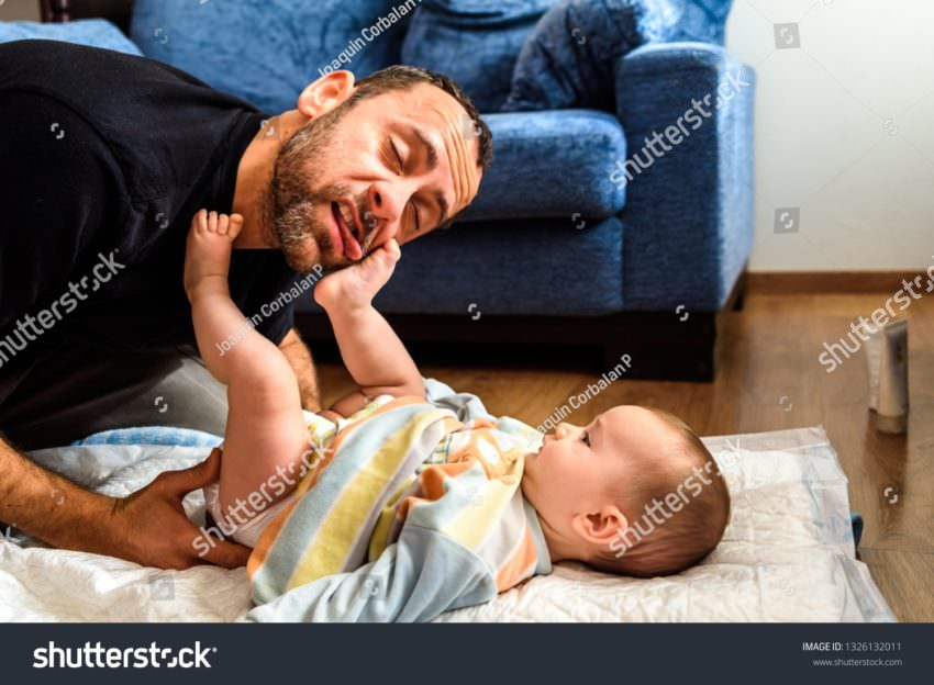 Stock Photo Dad Struggling With His Baby Daughter To Change Dirty Diapers Putting Faces Of Effort Concept Of 1326132011