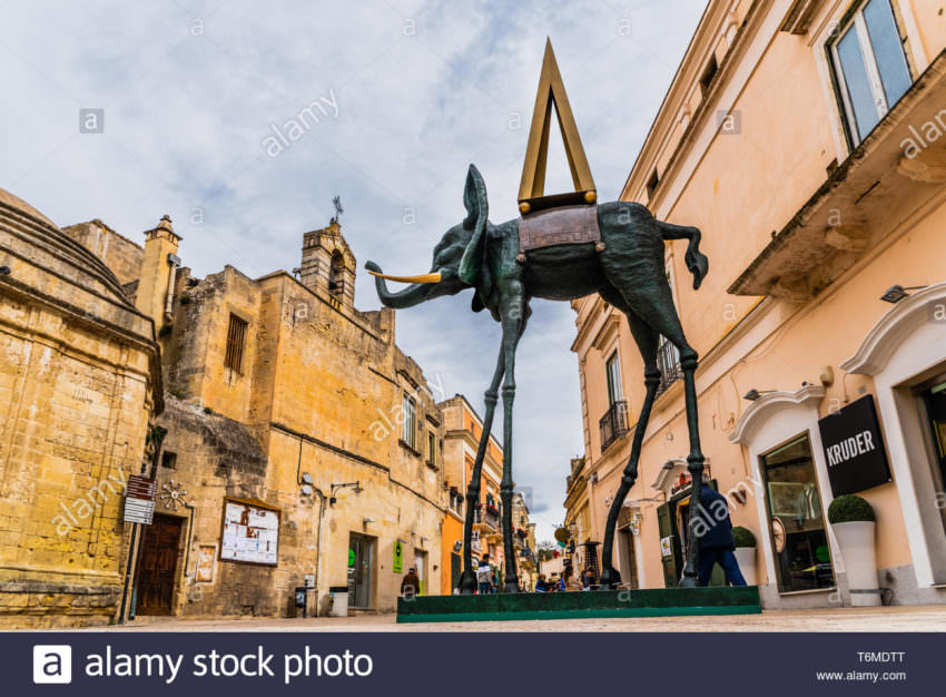 Replica of a sculpture of Dali, a deformed elephant, exposed on the street in Matera, Italy.