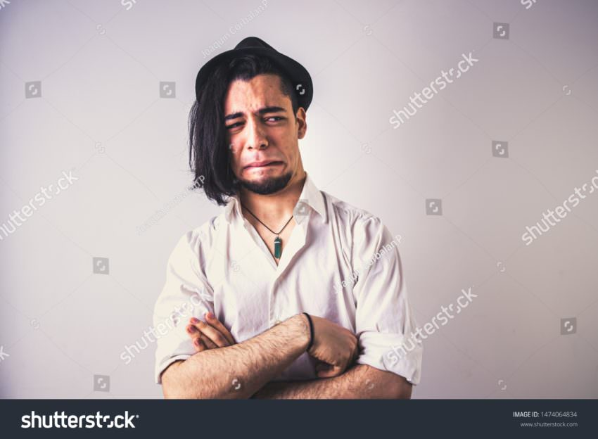 Stock Photo Portrait Of Young Latin With Disgusted Face And Disgust Isolated On White Background Faded 1474064834