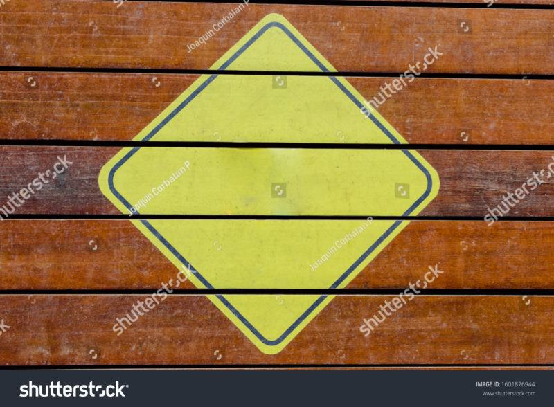 Stock Photo Blank Yellow Triangular Caution Sign Ready To Fill With Text 1601876944