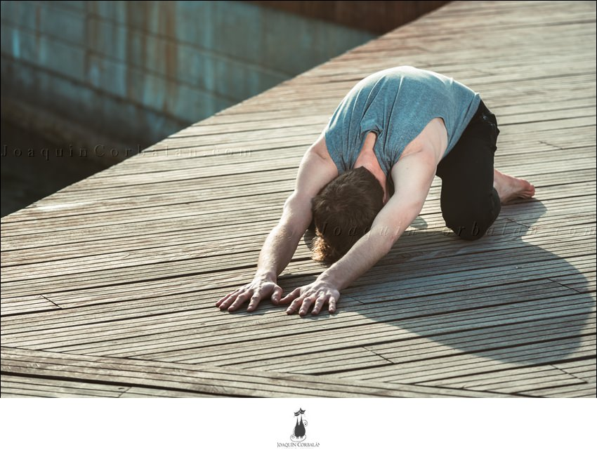 Balasana Is A Yoga Posture To Avoid Back Pain, A Young Man Practices It.