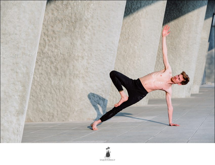 Vasisthasana On The Cement Of The City, Yoga Posture To Exercise The Core.