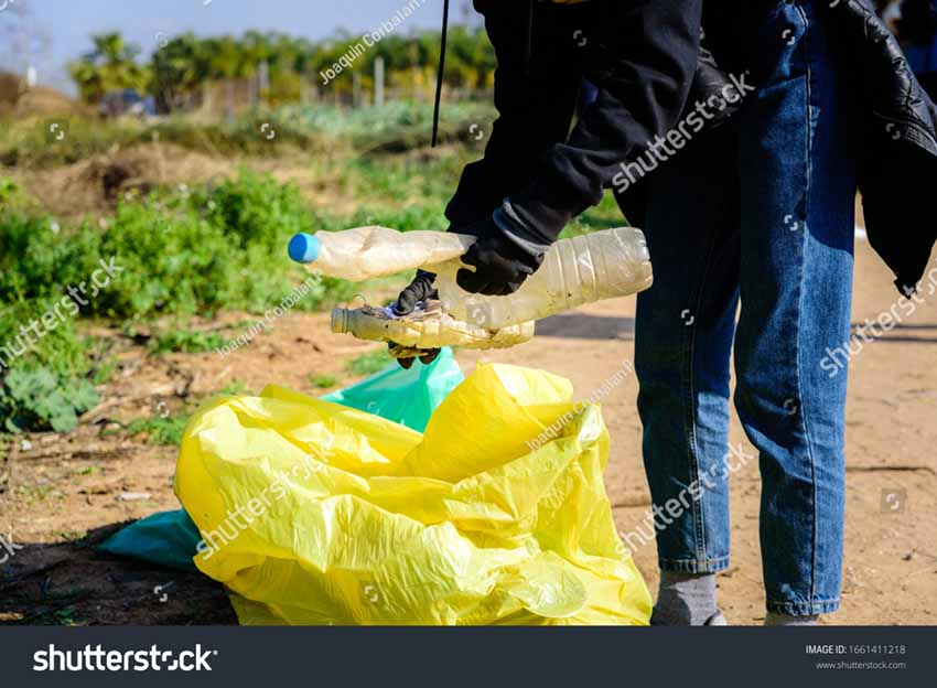 Stock Photo Volunteers Collect Plastic Garbage From A Contaminated Natural Environment And Store It In Bags 1661411218