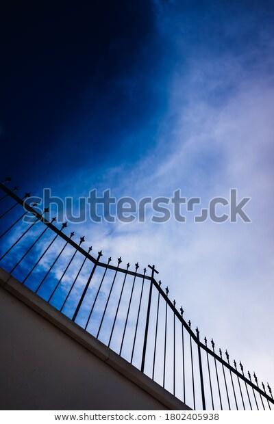 Silhouette Spooky Graveyard Fence Blue 600w 1802405938